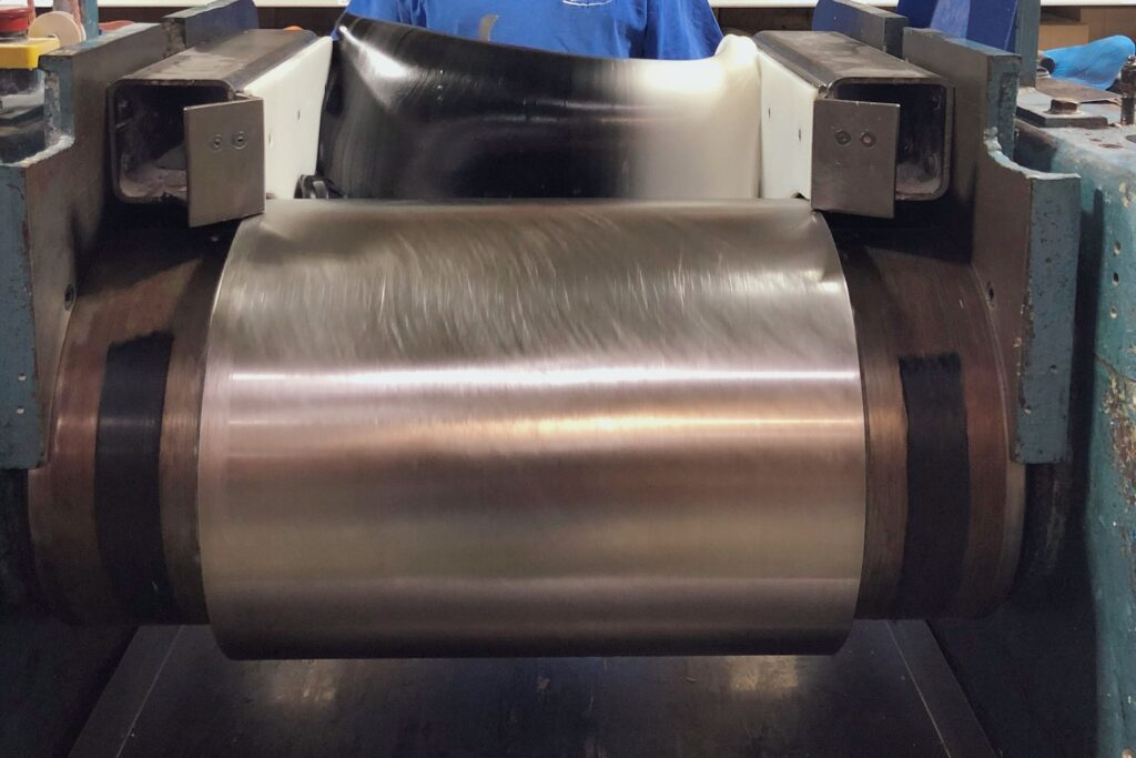 Grey silicone being mixed in a milling machine